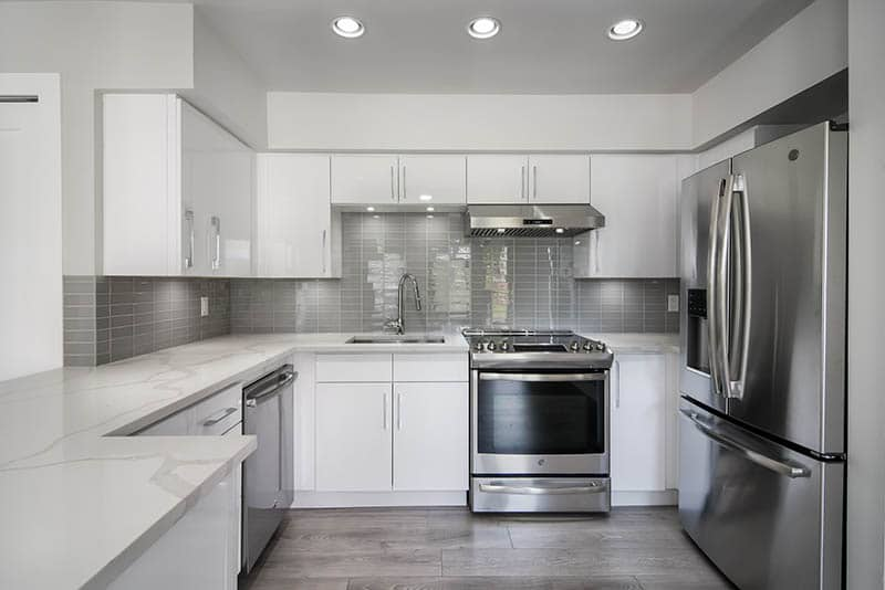 Tons Of Storage In A Bright White Kitchen Renovation