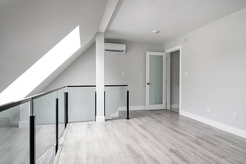 Nice Glass Railing In Remodeled Loft Area