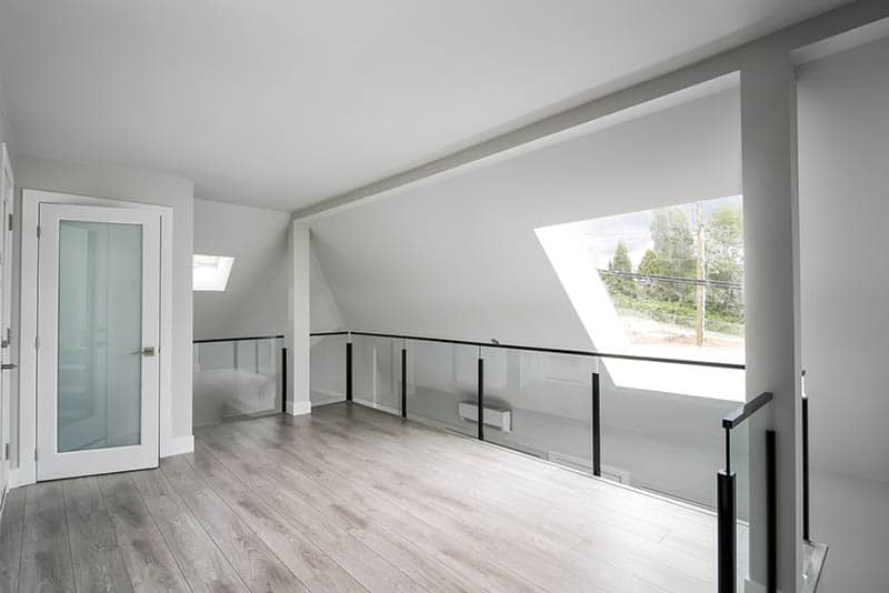 Glass Railing And Skylight In Renovated Loft