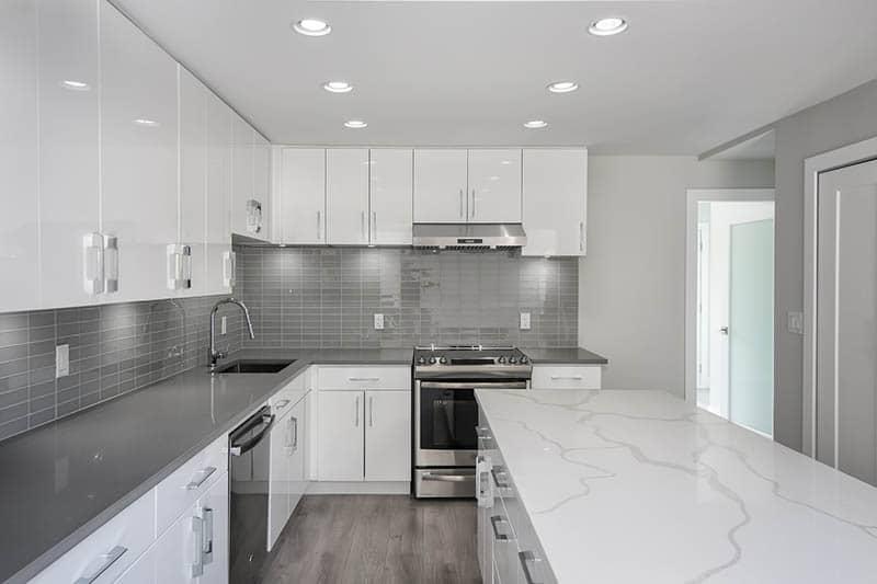 Two Tone Quartz Countertops In Bright Renovated Kitchen